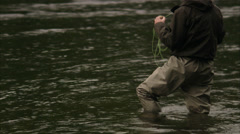 A man fly-fishing in a river, Vindalsalven, Sweden. Stock Footage