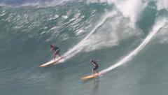 Surfers on Giant Waves, Waimea Bay, Hawaii Stock Footage