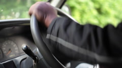 Black man drive steering car wheel, right side, Kenya Stock Footage