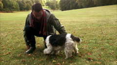 A woman and a dog outdoors an autumn day, Sweden. Stock Footage