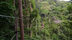 Extreme Young Woman on Zip Line in Jungle Stock Footage