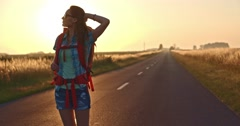 Traveler woman walking on a sunny road. Stock Footage