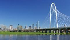 4k Dallas skyline w/ Margaret Hunt Hill bridge on clear day Stock Footage