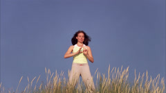 A woman doing qi gong by the sea, Sweden. Stock Footage