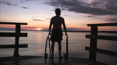 A man in the sunset by the sea, Sweden. Stock Footage