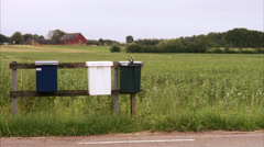 Letterboxes by a country road, Sweden. Stock Footage