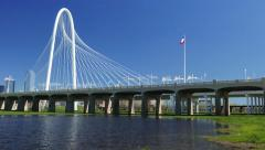 4K-UHD Dallas' Margaret Hunt Hill bridge w/water and Texas Flag Stock Footage