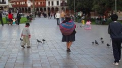 Tourists walking in park near Cusco Cathedral Stock Footage