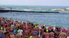 SWIMMERS START race in ocean Stock Footage
