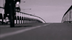 A cyclist on a bridge, Vasterbron, in Stockholm, Stock Footage