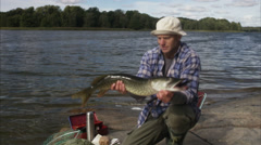 A man holding a big pike, Sweden. Stock Footage