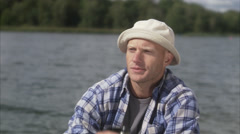A man having a coffee break during a fishing tour, Sweden. Stock Footage