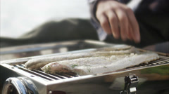 Fresh fish being grilled, Sweden. Stock Footage