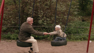 Stock Video Footage of An elderly man with granddaughter in a playground, Sweden.