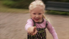 A girl playing in a playground, Sweden. Stock Footage