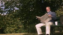 An elderly man sitting on a bench, Sweden. Stock Footage