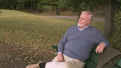 An elderly man sitting on a bench, Sweden. Stock Footage