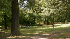 Father and son playing football in a park a sunny day, Sweden. - stock footage