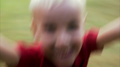 A blond boy is spinning around, Sweden. Stock Footage