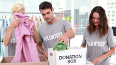 Volunteers friends holding donation boxes Stock Footage