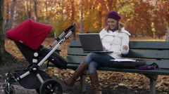 Stock Video Footage of A mother with a perambulator using a laptop, Sweden.