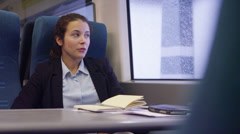 4k, tired, young businesswoman prepares to get off commuter train Stock Footage