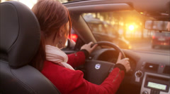 A young woman driving a cabriolet in a city, Stockholm, Sweden. Stock Footage