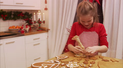 Decorating gingerbread biscuits, Sweden. - stock footage