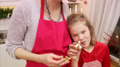 Mother and daughter eating gingerbread biscuits, Sweden. - stock footage