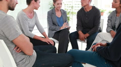 Group therapy in session sitting in a circle Stock Footage
