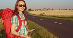 Traveler woman with tablet. Young smiling backpacker woman using digital tablet Stock Footage