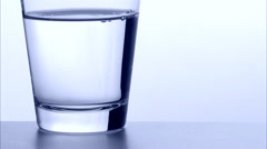 An effervescent tablet and a glass of water, close-up. Stock Footage