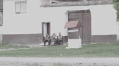 Romanian People in Front of House -Cine Gamma- Stock Footage