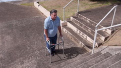 DISABLED-PARAPLEGIC man with walker and park stairs obstacle 2 Stock Footage