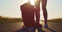 Traveler woman picking up her backpack. Stock Footage