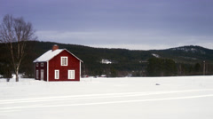 A red house in a winter landscape, Sweden. Stock Footage
