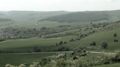 Grasslands with village in Romania -Graded- Stock Footage