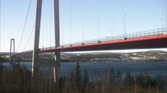 Traffic on a bridge, Hoga kusten bridge, Sweden. - stock footage