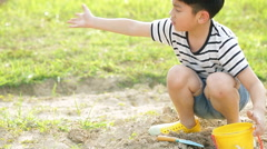 Asian cute boy playing with toys in garden,dolly camera Stock Footage