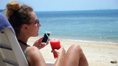 Female with Phone in Happy Summer Holidays on Beach Stock Footage