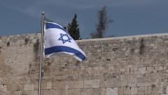 Israel national flag fly in Western Wall  Jerusalem Stock Footage