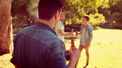 Three friends in the park having barbecue and drinking beer Stock Footage