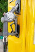 old fuel nozzle dispenser - stock photo
