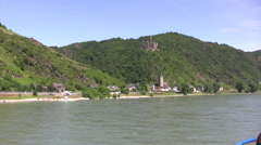 Distant view of Wellmich in Germany on the banks of the Rhine river Stock Footage
