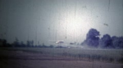 ARKANSAS, USA - 1966: Airplane crop dusting over soybean fields. - stock footage