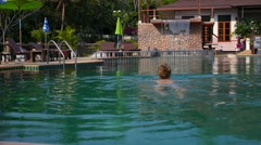 Luxury Spa Recreation and Relaxation on Vacation - Woman in Pool. Slow Motion Stock Footage