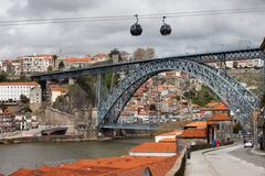Dom Luis I Bridge in Porto and Cable Car in Gaia - stock photo