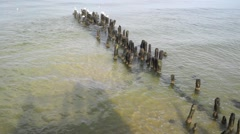 Overlooking the Baltic Sea close to the shore, Shadow from people on pier Stock Footage
