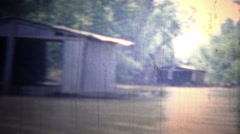 ARKANSAS, USA - 1965: Floating boathouses and living units on the flooded river. - stock footage