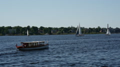 Small cruise ship and sailboats at the River Daugava in Riga Latvia Stock Footage